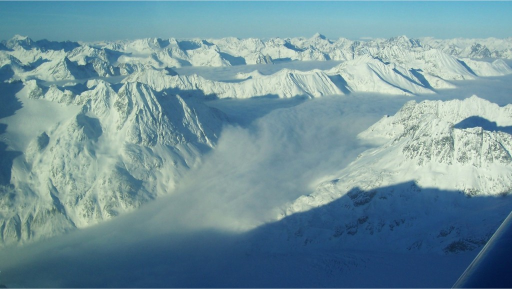 Flying Over Snowy Mountains